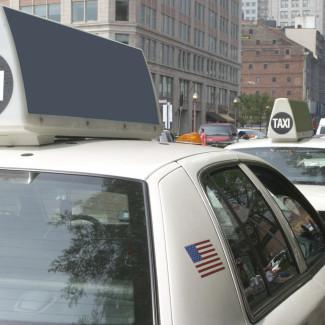 iStock_000003160385Medium - Row of White Taxis
